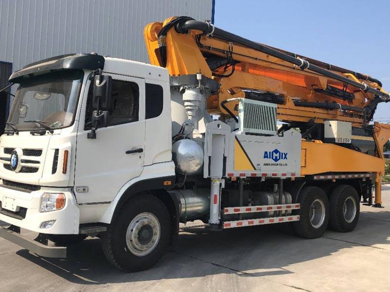 Truck mounted boom concrete mixer pump